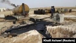 Доморобна очистка нафти «Ісламської держави» неподалік Ідліба в Сирії, фото 16 грудня 2015 року