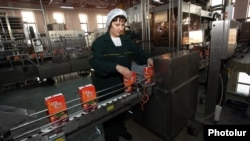 Armenia - A worker at a beverage plant in Yerevan, Feb42013.