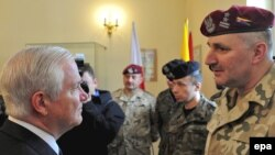 U.S. Defense Secretary Robert Gates (left) meets with Polish soldiers after signing a memorandum on cooperation between the Polish and U.S. militaries in Krakow.