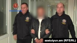 Georgia - A screenshot of official video of the arrest in Tbilisi of an Armenian man suspected of smuggling weapons to Armenia, 27Mar2017.