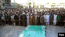 Purported file photo of of the funeral of six Pakistani Shi'ite fighters in Qom, Iran. They were killed in Syria.