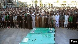 FILE: A funeral of Pakistani fighters killed in Syria in Qom.