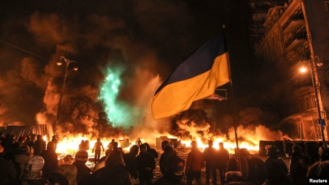 Antigovernment protesters gather in front of burning tires during clashes with riot police in Kyiv on the night of January 22-23.
