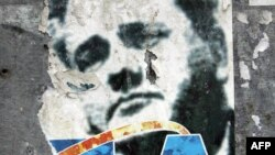 Serbia - A ripped poster of former Yugoslav President Slobodan Milosevic is seen in central Belgrade, 05 October 2005