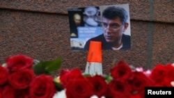 A photo and flowers on February 28 at the site where Boris Nemtsov was shot dead, near the Kremlin in central Moscow