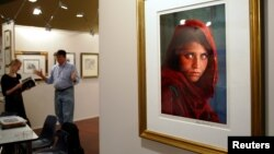 The famous portrait of Sharbat Gula is shown displayed at an art fair in Sydney, Australia, in 2005.