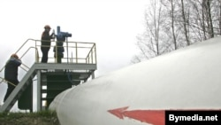 Workers at a station on the Druzhba pipeline in Belarus