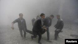 Президент Башар Асадга лоялдуу күчтөр Дамасктын жанындагы Дама деген жерге аба соккуларын жасагандан кийин. 2-февраль, 2015-жыл.