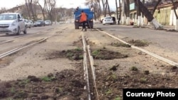 Uzbekistan - filling tram lines holes with soil