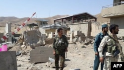 Afghan security forces inspect the site of a special-forces base Logar province on August 6.