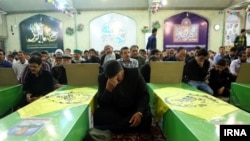 Mourners attend an Iranian funeral of Afghan fighters killed in Syria.