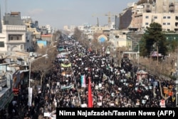 Iranian pro-government supporters march during a rally in support of the regime in the city of Mashhad late last week.