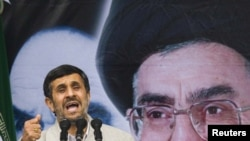 President Mahmud Ahmadinejad takes part in a demonstration to mark the 32nd anniversary of the Islamic Revolution in Tehran today.