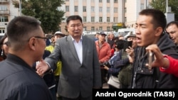 Communist Party politician Vyacheslav Markhayev (right) at a protest in the Siberian city of Ulan-Ude on September 10.