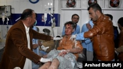 A man injured in a bomb explosion is treated at a hospital in Quetta, Balochistan on January 7.