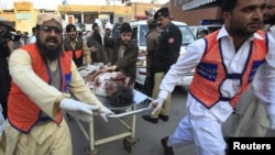 Medics assist a man injured by suicide bomb attacks in Pakistan's northwestern Mohmand region.