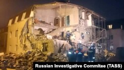 Rescuers work at the site of a partially collapsed residential building after a gas explosion in the Siberian city of Krasnoyarsk late on February 14.
