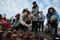 Residents of Sochi place candles and lay flowers in tribute to the victims of the crash.
