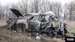 A burned-out OSCE vehicle that hit a land mine in eastern Ukraine on April 23, killing one paramedic.