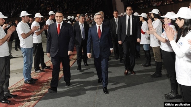 Armenia - President Serzh Sarkisian (R) and Orinats Yerkir Party leader Artur Baghdasarian are greeted by party activists at an event in Yerevan, 20Mar2012.
