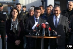 Pro-Kurdish Peace and Democracy Party (BDP) co-chairman Selahattin Demirtas (center) with pro-Kurdish politicians at a press conference in Istanbul (file photo)