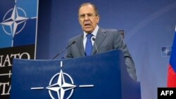 Russian Foreign Minister Sergei Lavrov gives a press conference following a meeting of NATO ministers at the alliance's headquarters in Brussels in December 2013.