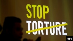 Philippines -- A Filipino anti-torture advocate speaks during a press conference about the global campaign against torture in Quezon city, east of Manila, May 13, 2014