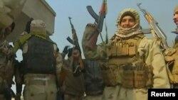 Иракские правительственные подразделения после победы в сражении с ИГ. Окрестности Мосула, 7 декабря 2016 года.