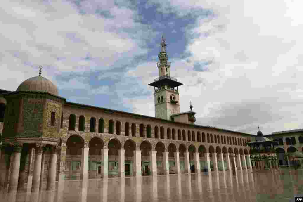 The courtyard of the Umayyad Mosque in old Damascus, 2010. The Umayyad Mosque, also known as the Grand Mosque of Damascus, was built on the Christian basilica dedicated to John the Baptist since the time of Roman Emperor Constantine I.