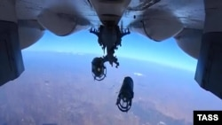 A Russian Su-30 fighter drops bombs over Syria on October 15.