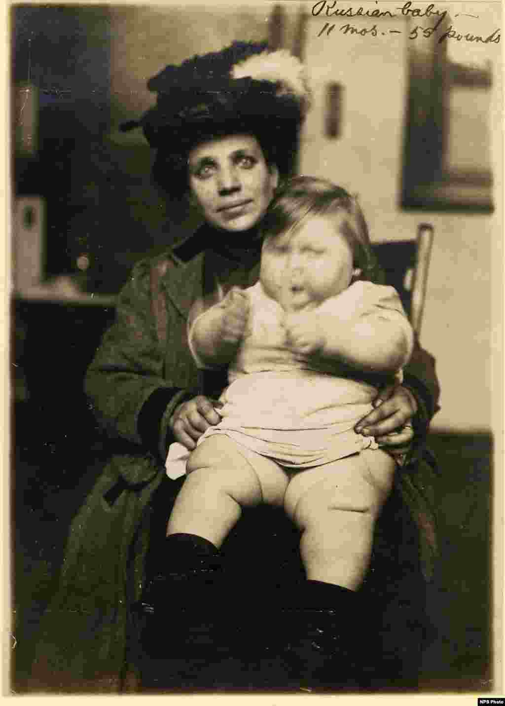 A Russian mother with her baby. At the time of the photo, the child was 11 months old and weighed 55 pounds (25 kilograms).