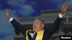 Kazakh President Nursultan Nazarbaev greets his supporters during a postelection rally in Astana.