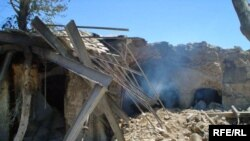 Buildings destroyed in earlier fighting in Helmand Province (file photo)
