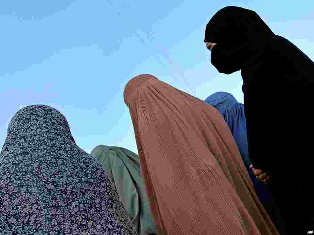 Afghan women attend a U.S.-sponsored ceremony to mark International Women's Day on March 8 in Helmand Province. - Photo by Behrouz Mehri for AFP