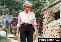 Princess Diana leaves the house of land-mine victim Mirzeta Gabelic (not pictured) during her visit to Sarajevo in August 1997, shortly before her death.
