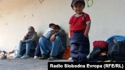 Children and parents rest at a train station in Demir Kapija on their way to the Serbian border on June 15. ​Macedonia's Interior Ministry says the number of illegal migrants has quadrupled in the past four months. Thousands of migrants are now entering the country every week, officials say.