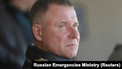 Russian Emergencies Minister Yevgeny Zinichev looks on during a drill in the Krasnoyarsk region on September 7.