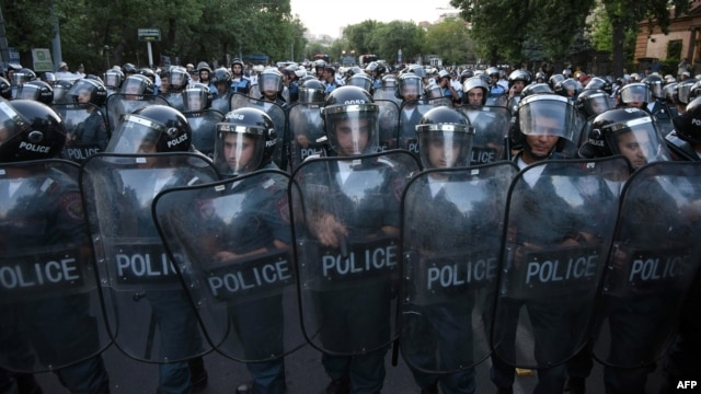 Armenia -- Police block a street during a protest against an increase of electricity prices in Yerevan, June 23, 2015