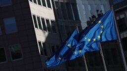 European flags flutter outside the EU Commission headquarters in Brussels.