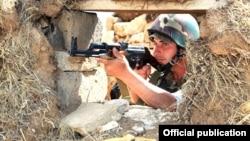Armenia - An Armenian soldier on the border with Azerbaijan, 22Aug2011.