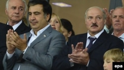 Georgian President Mikheil Saakashvili (left) and his Belarusian counterpart, Alyaksandr Lukashenka (right), with his son, Mykalay, attend the Euro 2012 final in Kyiv.