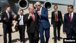 U.S. Secretary of State John Kerry (centre-right) talks with Kurdish officials in Iraq.