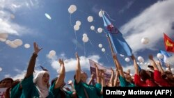 Kyrgyz students release white balloons as they protest against bride kidnapping in downtown Bishkek.