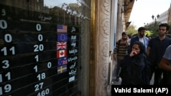 An exchange shop displays rates for various currencies, in downtown Tehran, October 2, 2018. No rates are advertised for the US dollar and the euro.