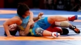 Indonesia-Wrestling - 2018 Asian Games – Women's Freestyle 53 kg Gold Medal Final - JCC – Assembly Hall - Jakarta, Indonesia – August 20, 2018 – Pak Yong Mi of North Korea in action with Zhuldyz Eshimova of Kazakhstan. REUTERS/Issei Kato