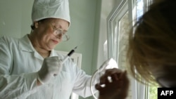 A doctor takes a blood test at the regional medical AIDS center in the southern Russian city of Rostov on Don.
