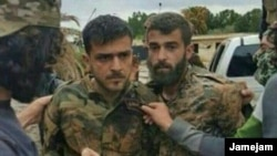A photo allegedly showing a member of Iran's Islamic Revolutionary Guards Corps after being captured by opposition forces in Syria.