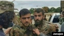 A photo allegedly showing Islamic Revolutionary Guards Corps members in Syria captured by opposition forces.