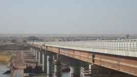 Tajik analysts say a new U.S.-built bridge connecting the country with Afghanistan could be used to extract supplies.