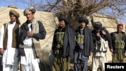 Afghanistan -- Taliban militants stand, after voluntarily handing over their weapons and joining the government, in Sangin district of Helmand Province, 01Jan2011